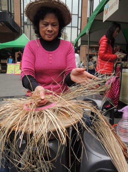 Woman weaving with rushes, Taiwan.