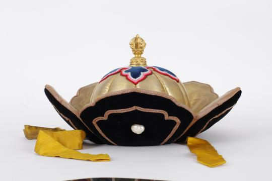 Petal crown of Bogd Khaan, with gold, silver, pearl, Indian gyasar gold-thread brocade, velvet, early 20th century, Bogd Khaan Palace Museum, Ulaan Baatar, Mongolia.