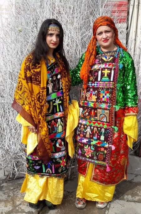 Suzan Sukari (right) and her daughter (left), wearing modern charugas.